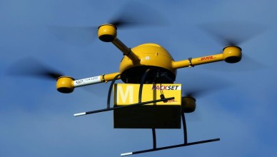 An unmanned aerial vehicle (UAV) carries a parcel in Bonn, Germany, 09 December 2013. Deutsche Post DHLhas for the first time tested parcel deliveries with a drone. Photo by: Oliver Berg/picture-alliance/dpa/AP Images